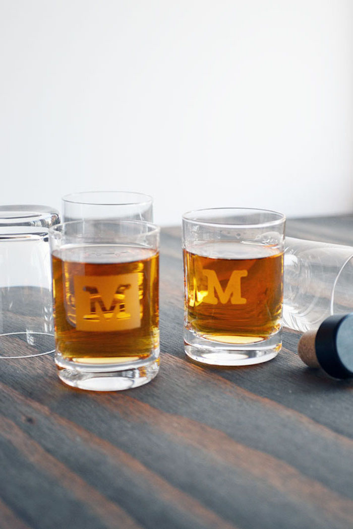 shot glasses personalised with initial best christmas gifts for dad placed on wood surface