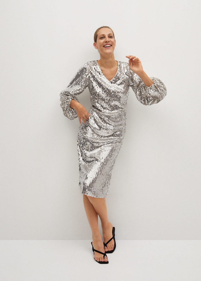 silver sequin dress with long puff sleeves worn by blonde women womens wedding guest dresses black sandals