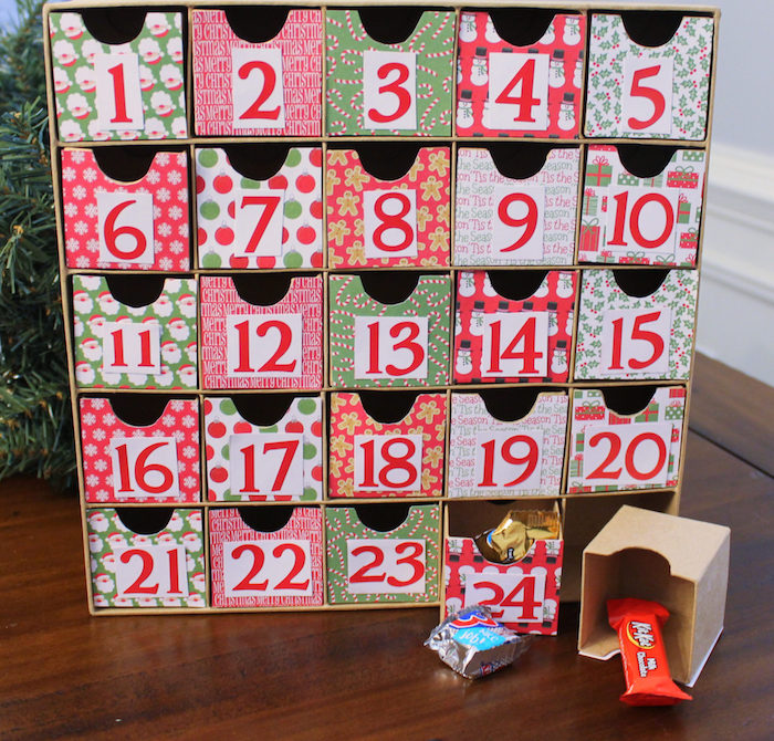 small carton boxes decorated with different christmas themed wrapping paper fun advent calendars candy in each box