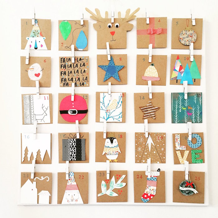 small cartons with different christmas themed decorations and numbers hanging on white wall fun advent calendars