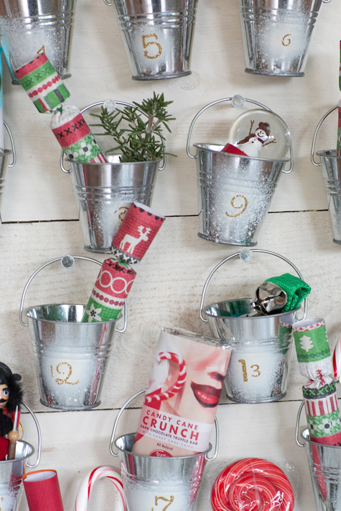 small metal buckets attached to wooden boards how to make an advent calendar filled with different items and candy