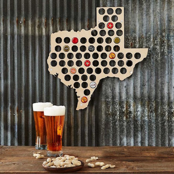 state map with holes which fit beer bottle caps gifts for dad from daughter two glasses of beer and peanuts placed on wooden floor