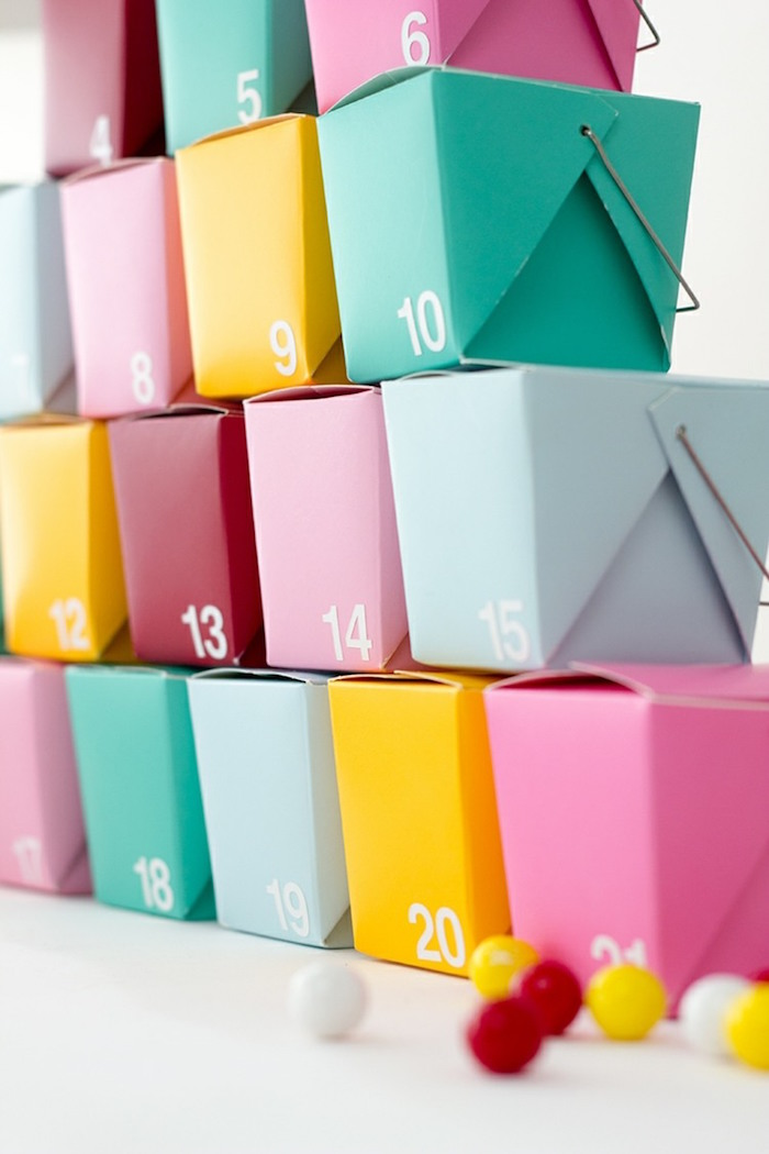 take out boxes in different colors arranged as christmas tree how to make an advent calendar labeled with numbers