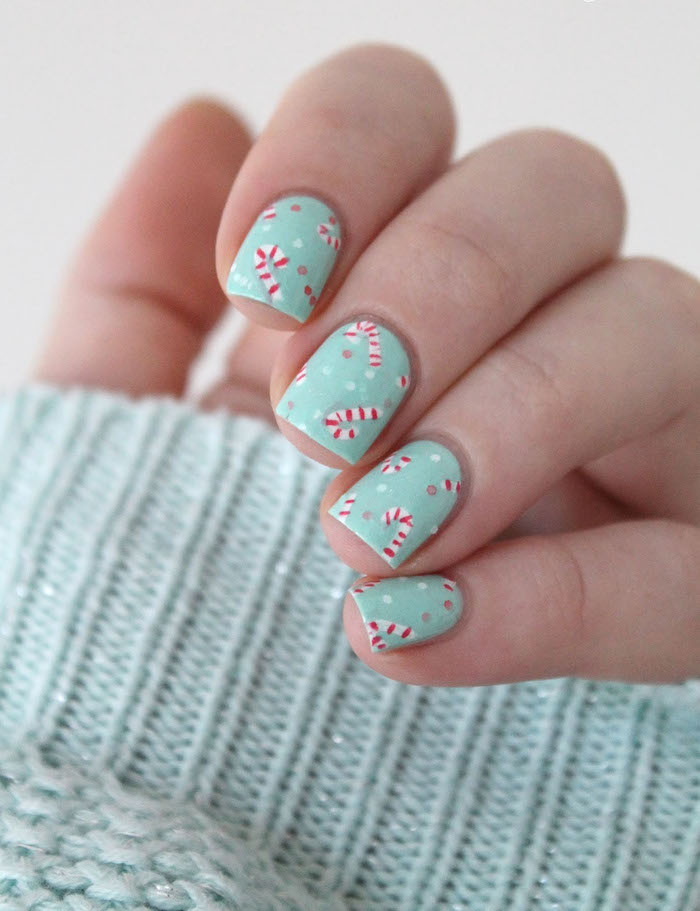 turquoise nail polish with candy cane decorations on short square nails christmas nail designs 2020