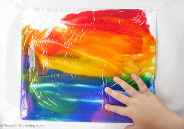 what to do on a rainy day no mess painting bag with paint in all colors of the rainbow placed on white surface