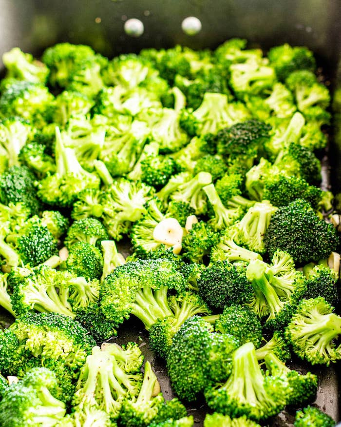 what to make on thanksgiving close up photo of lots of broccoli arranged in baking dish