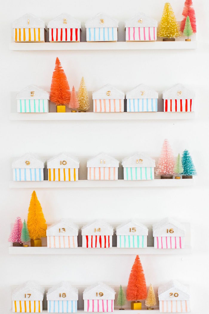 white wooden shelves mounted on white wall advent calendar ideas small boxes with numbers arranged on them with mini faux christmas trees