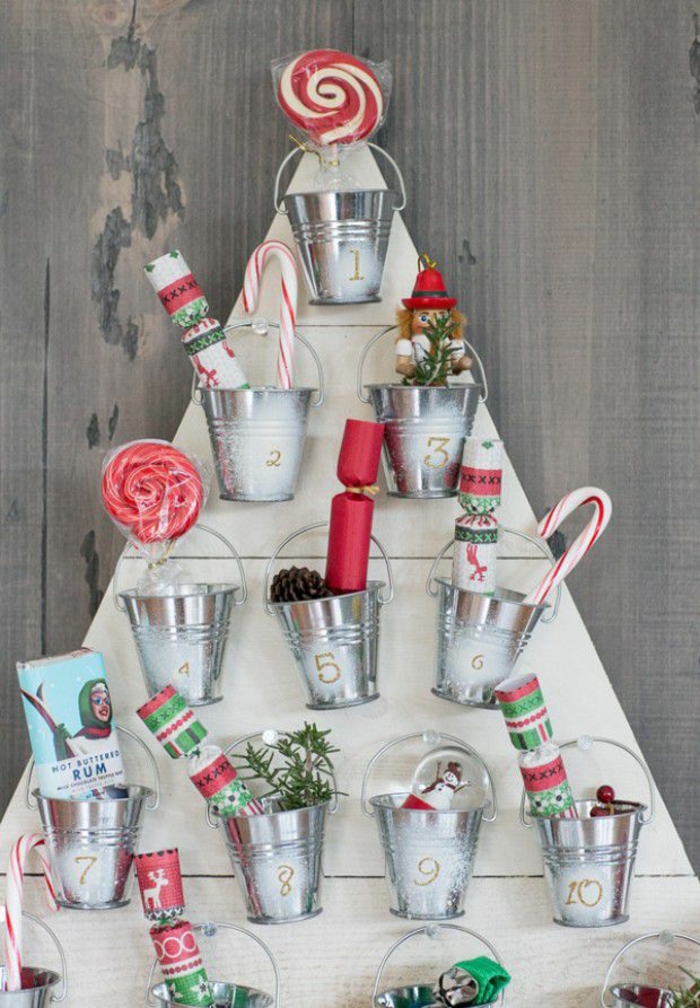 wooden boards in the shape of christmas tree how to make an advent calendar small metal buckets attached to it filled with candy
