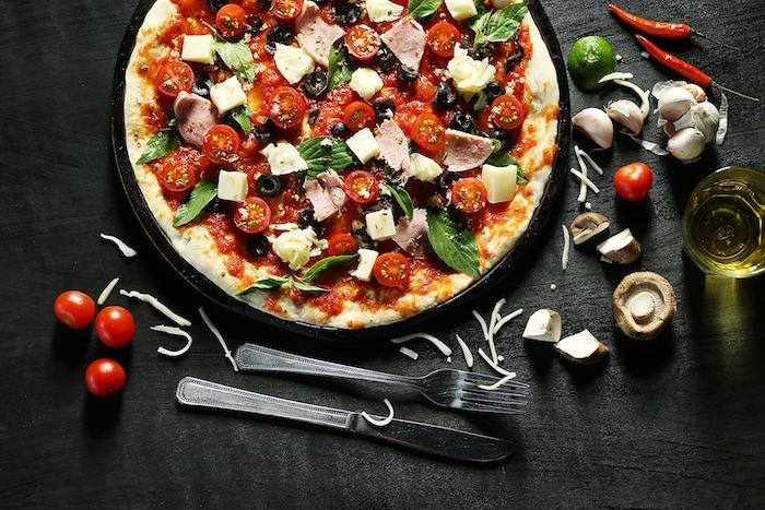best pizza dough recipe ham pizza with halved cherry tomatoes mushrooms olives garnished with fresh mint leaves