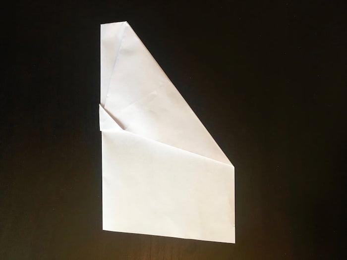 black background step by step diy tutorial paper airplane folding white piece of paper turned into a plane