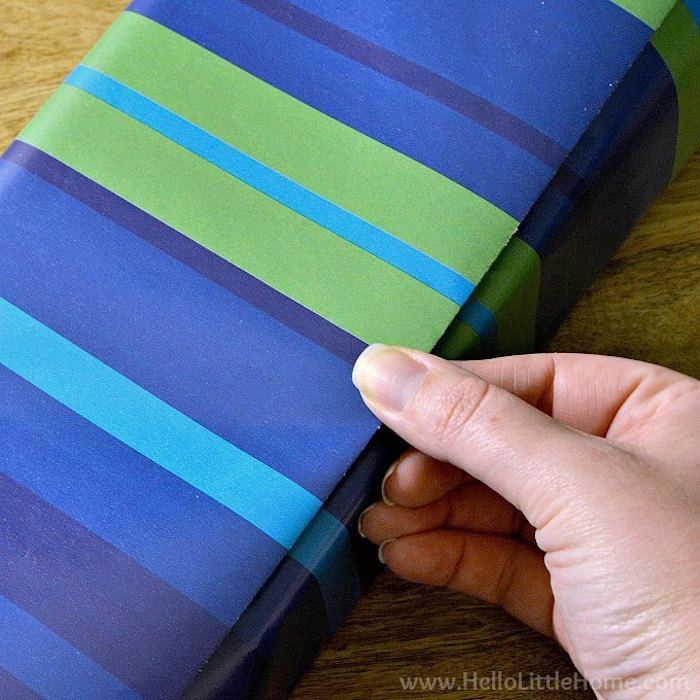 christmas gift wrapping ideas step by step diy tutorial made with wrapping paper in different shades of blue and green