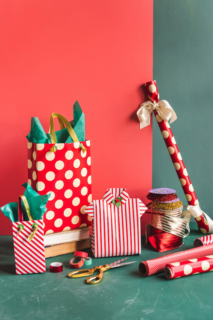 christmas presents arranged on green and red background how to wrap a gift wrapped with red and white wrapping paper and bags