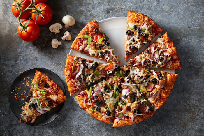 classic veggie pizza cut into slices homemade pizza recipe with onion mushrooms olives peppers