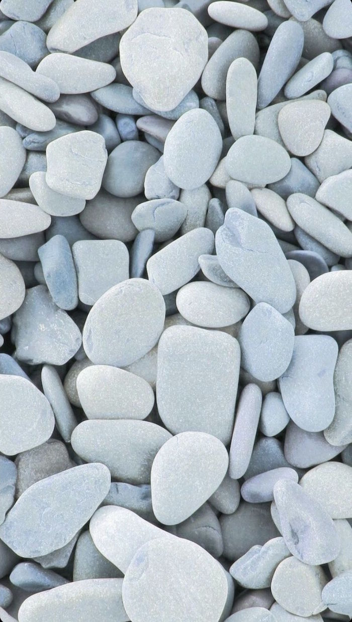 close up photo of lots of stones in different shapes minimalist aesthetic wallpaper different shades of gray