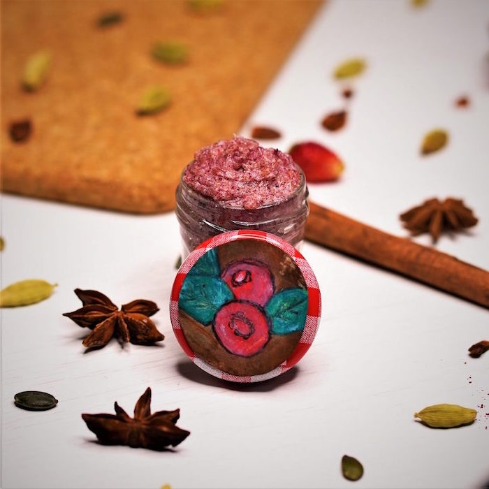 cranberries lip scrub diy lip scrub poured into small glass container star anise and cinnamon sticks around it