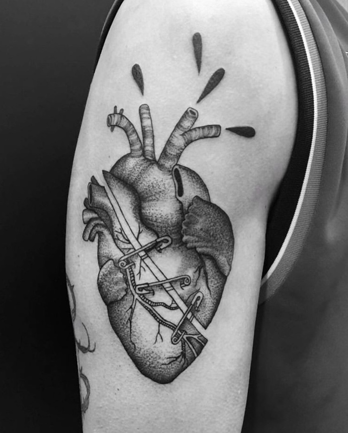 crying heart tattoo anatomically correct heart slashed in the middle held together with safety pins shoulder tattoo