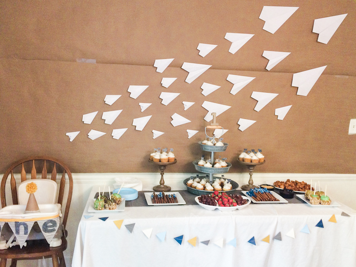 decoration of desserts table how to draw a paper airplane paper airplanes glued to the wall above the table