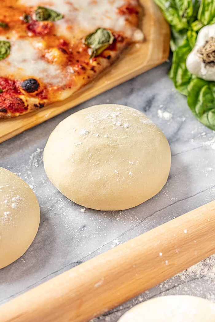 dough shaped into ball lightly floured placed on marble surface homemade pizza crust