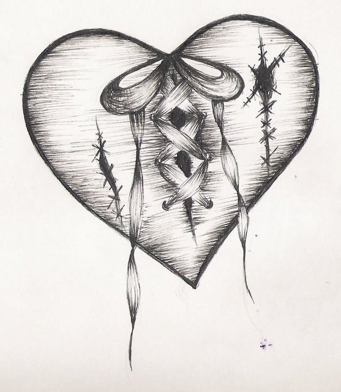 drawing of heart in black with stiches tied together in the middle with ribbon heart tattoo designs black and white drawing