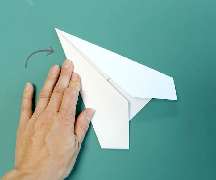 folding a piece of paper into a plane how to make a paper airplane easy step by step diy tutorial