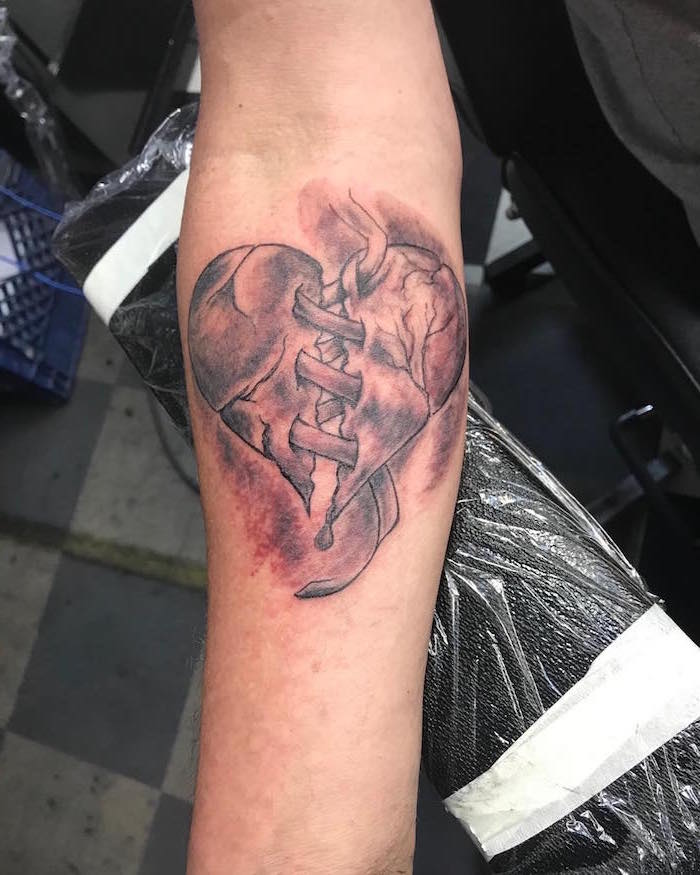 forearm tattoo heart tattoo on hand heart broken in the middle held together with bandages watercolor tattoo