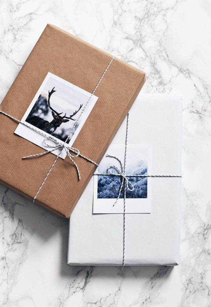 gift packing ideas two boxes wrapped in white and brown paper tied with small ribbons with two photos under the ribbons