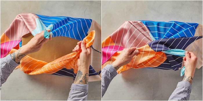 gift wrap ribbon big box being wrapped in silk fabric in blue orange purple pink stripes