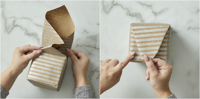 gray and gold wrapping paper wrapped around small box diagonal gift wrapping using japanese technique