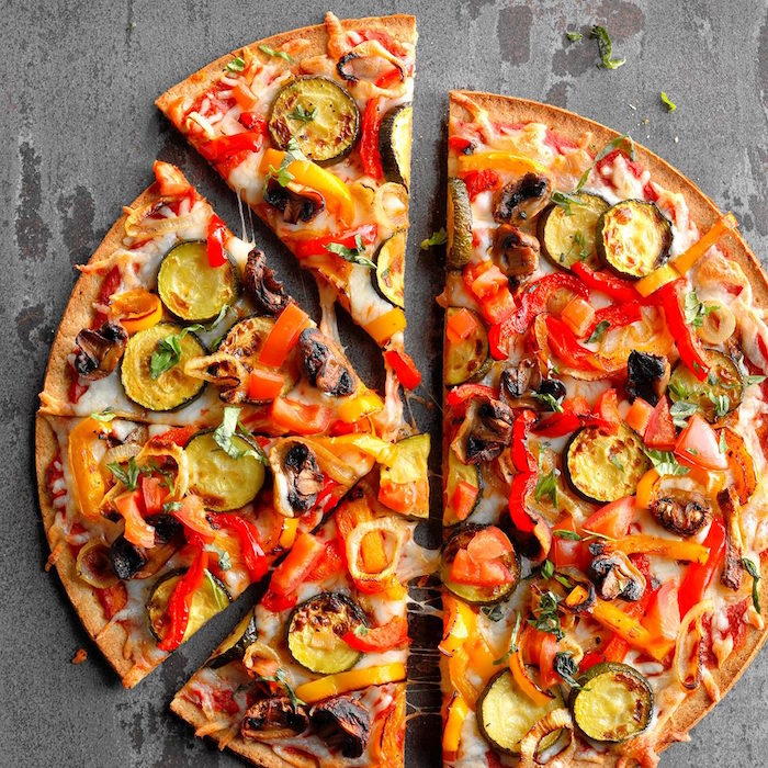 grilled veggie pizza with thin crust cut into slices homemade pizza dough with peppers mushrooms zucchini