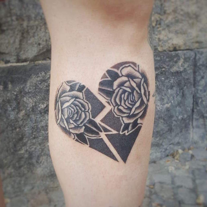 heart finger tattoo two pieces of a heart broken in the middle filled with black ink two roses inside back of leg tattoo