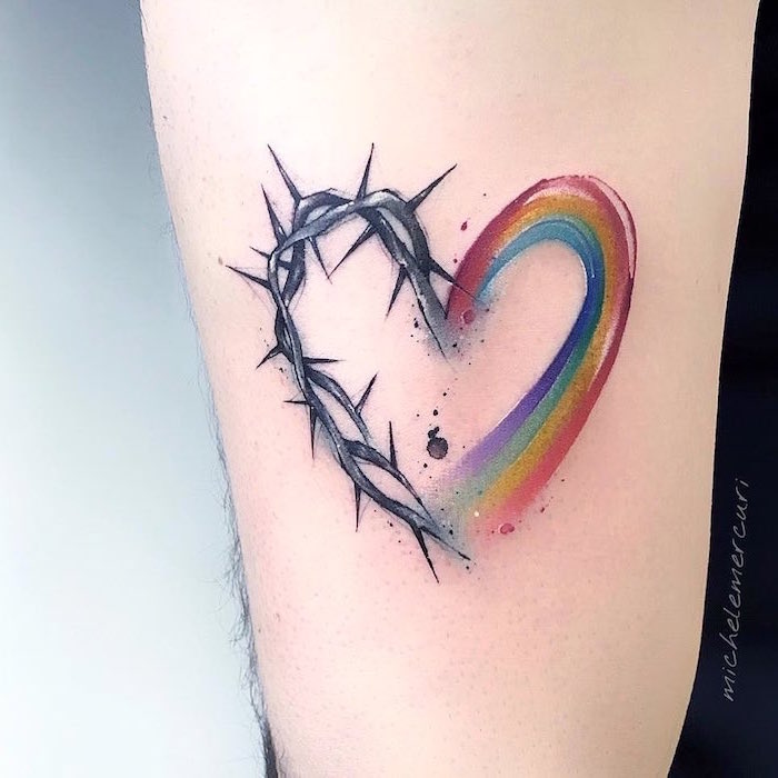 heart tattoo on chest forearm tattoo one half rainbow colors other half barbed wire watercolor tattoo