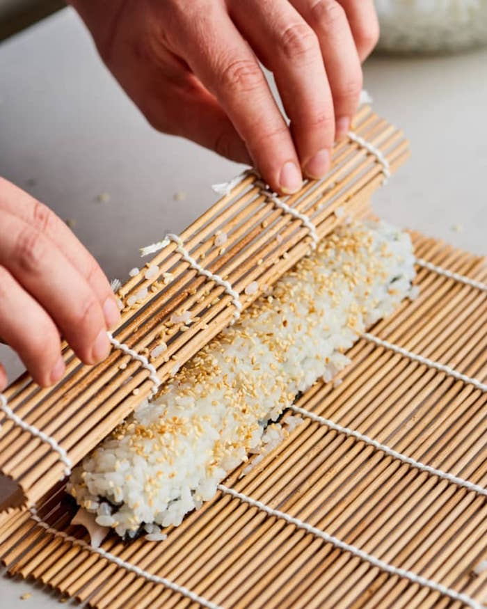 how to california roll with the help of bamboo mat dragon roll sushi with rice sesame seeds
