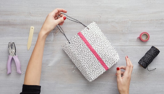how to wrap a christmas present diy gift bag made of white wrapping paper with black dots pink duct tape