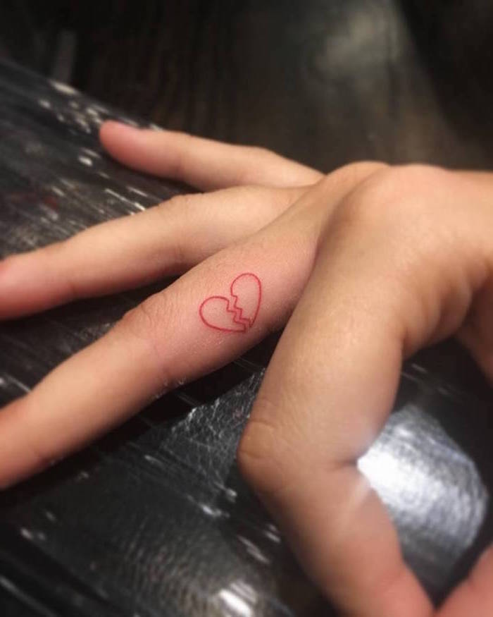 inside the finger tattoo crying heart tattoo red outline of heart broken in the middle