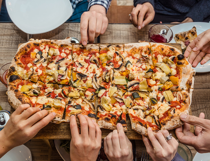 large rectangular pizza cut into slices best pizza dough recipe garnished with different vegetables mushrooms olives peppers onion