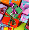 lots of presents wrapped in wrapping paper in different colors and ribbons how to wrap a gift pink green purple red orange blue