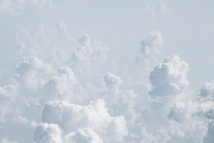 lots of white clouds in the sky minimalist background gray aesthetic foggy sky