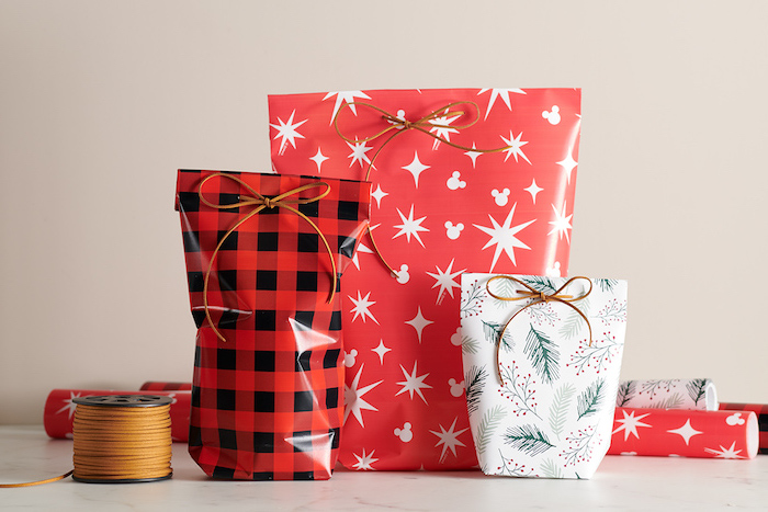 oddly shaped gifts wrapped in bags made from red and white wrapping paper how to wrap a present in bags