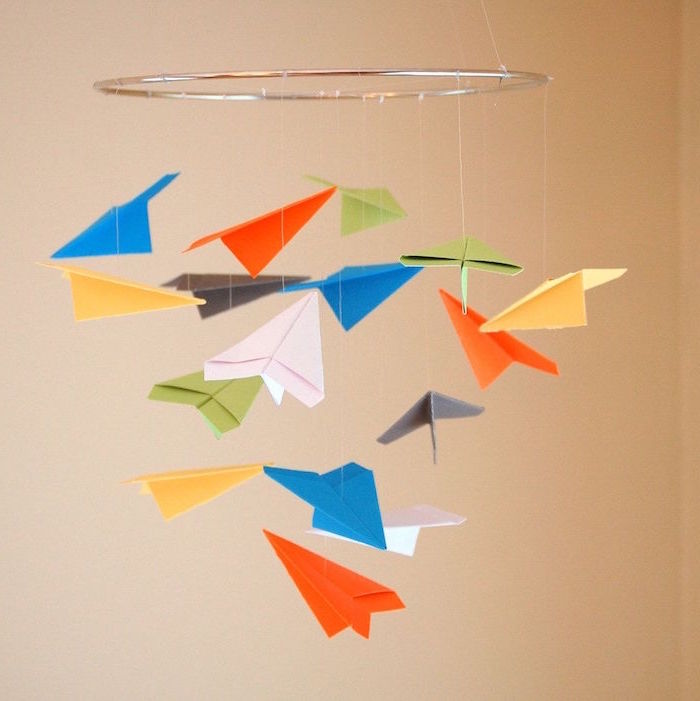 paper airplane decoration hanging from the ceiling how to fold a paper airplane gray metallic ring