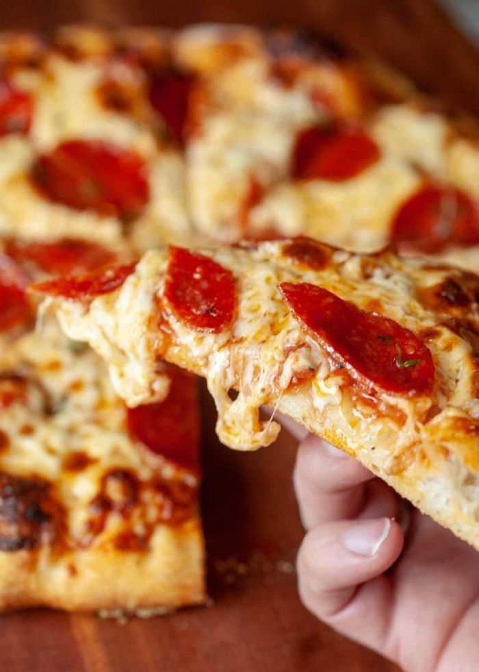 pepperoni pizza with lots of cheese thin crust pizza dough recipe cut into slices