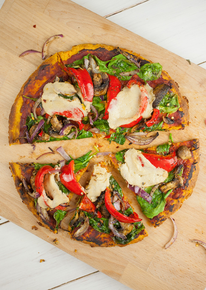 pizza with sweet potato crust homemade pizza dough recipe cut into slices with tomatoes pepper onion