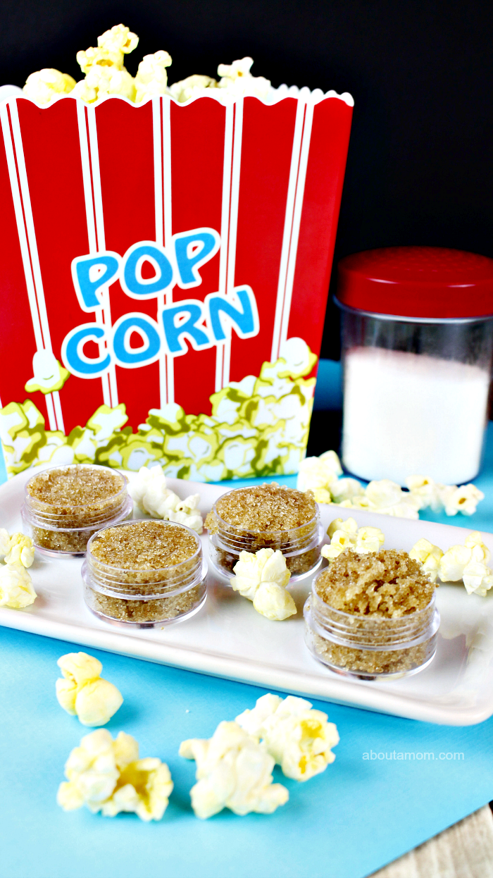 popcorn diy lip scrub in plastic container how to exfoliate lips popcorn scattered around it on white plate