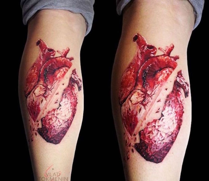 red anatomically correct heart slashed in the middle heart tattoo on wrist back of leg tattoo