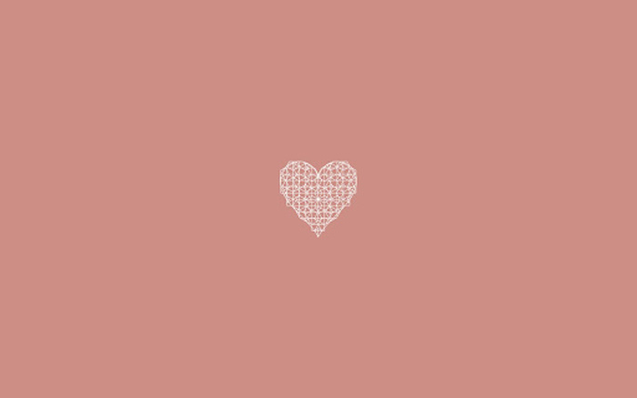 salmon pink background mminimalist desktop wallpaper mandala heart drawn in white in the middle