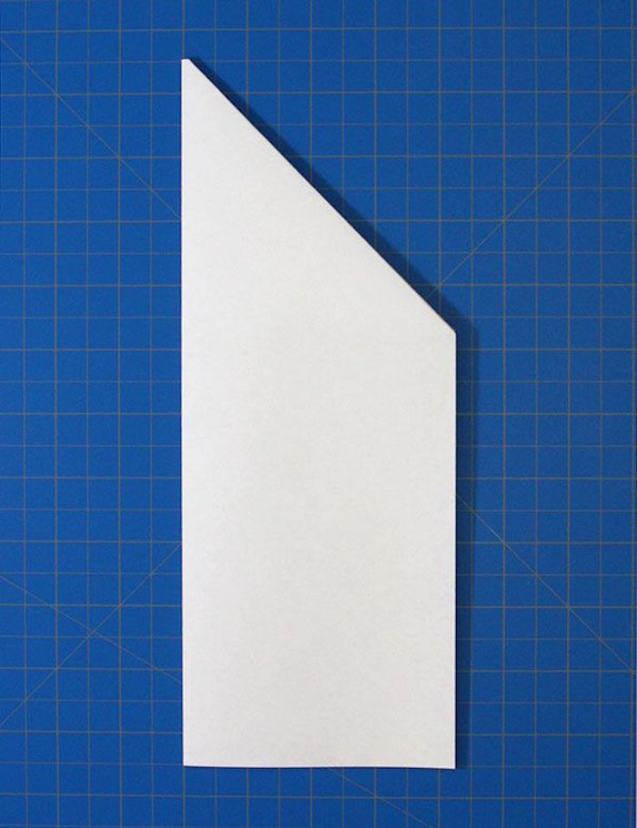 simple paper airplane white piece of paper placed on blue background being folded into plane