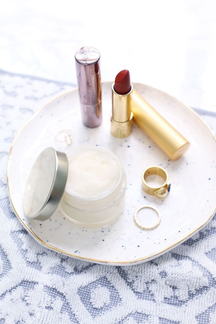 small ceramic plate with red lipstick two gold rings how to use lip scrub plastic container with lip scrub inside