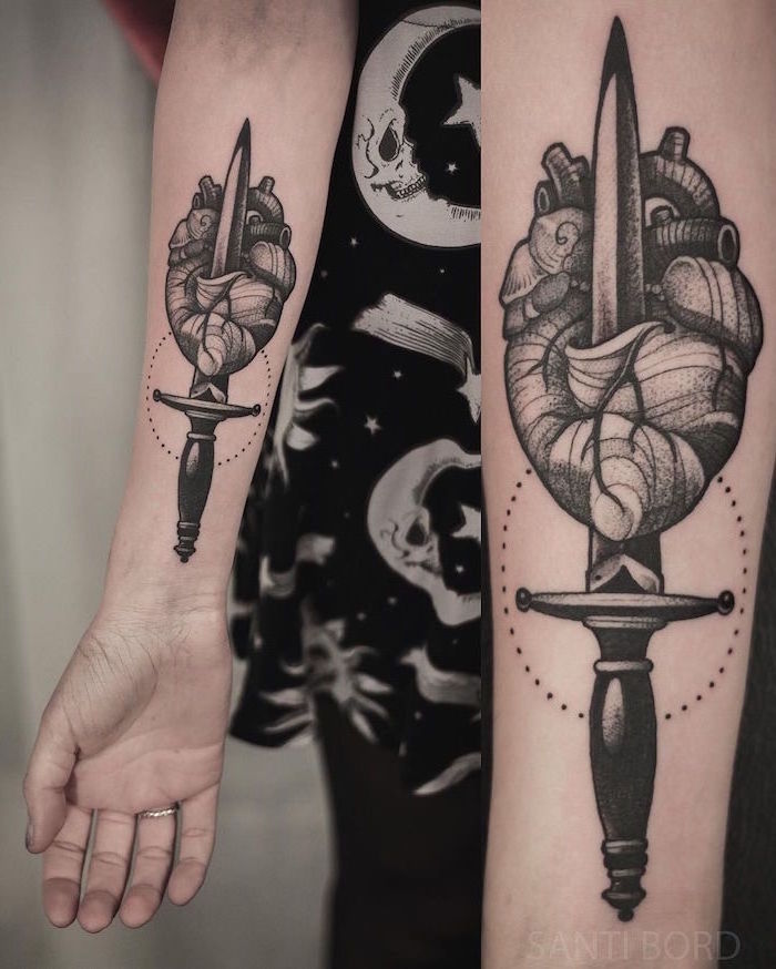 small heart tattoos forearm tattoo of anatomically correct heart with dagger going through it