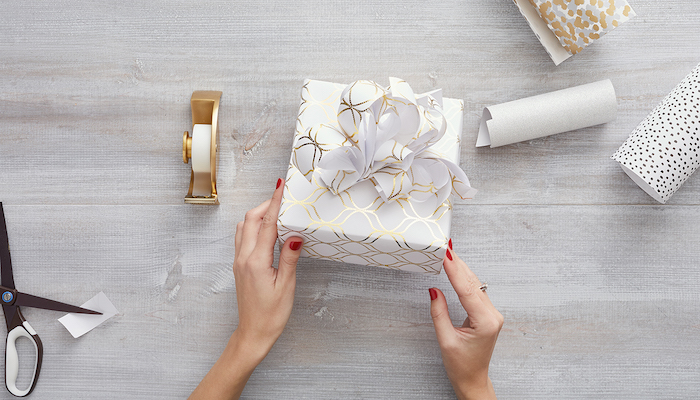 square box wrapped in white and gold wrapping paper with diy ribbon on top how to wrap a christmas present