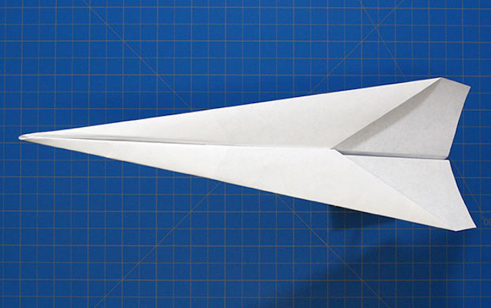 step by step diy tutorial how to make a paper airplane that flies far white piece of paper folded into plane