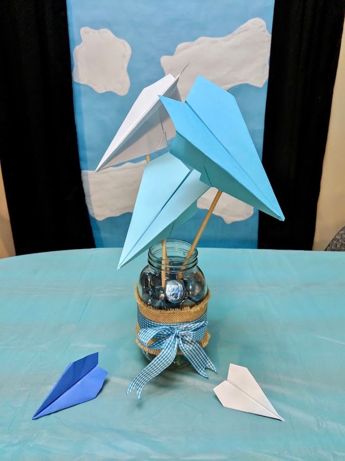 table centerpiece how to draw a paper airplane jar filled with chocolate candy three paper airplanes in blue and white